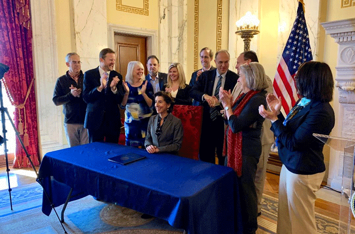 Gov. Gina Raimondo signing the executive order January 17, 2020, to advance a 100 percent renewable energy future for Rhode Island. Photo courtesy of State of RI.