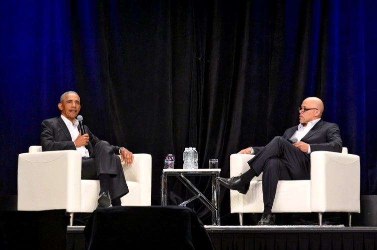 Dennis Kennedy (right) moderating a Q & A with former President Barack Obama at the 2019 National Diversity and Leadership Council.