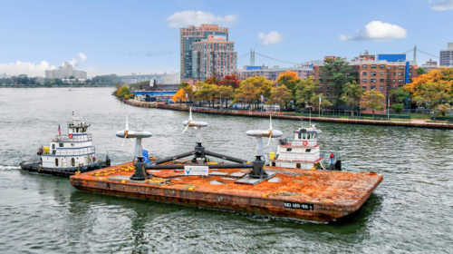 October 1, 2020 – Verdant Power's RITE project made the journey from New Jersey to New York City's East River with co-funding from the U.S. Department of Energy's Power and Technologies Office and the New York State Energy Research and Deployment Authority. Verdant Power's 2020 Roosevelt Island Tidal Energy Project features a TriFrame Mounting System and three fifth generation Free Flow System Turbines. (Photo by Paul Komosinski, Drone Altitude/for NREL.)