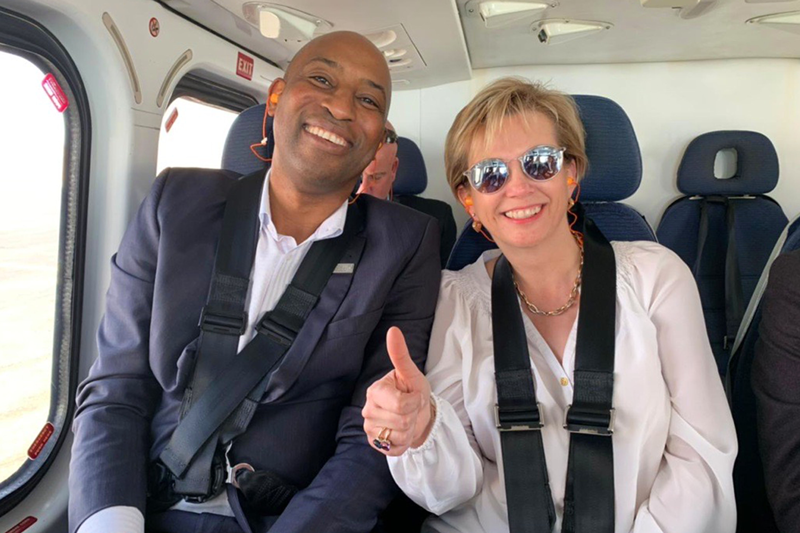 En route by helicopter to customer sites in Kuwait, Borras gives an all-clear with Tayo Akinokun, regional vice president of Middle East, Northern Africa and India for Oilfield Services at Baker Hughes. (2019)